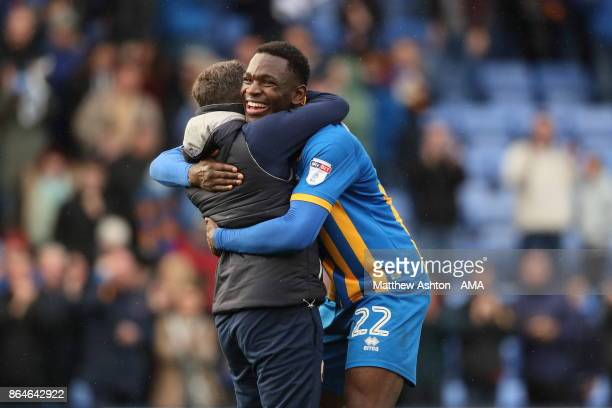 Aristote Nsiala of Shrewsbury Town celebrates victory with manager Paul Hurst during the Sky Bet League One match between Shrewsbury Town and...