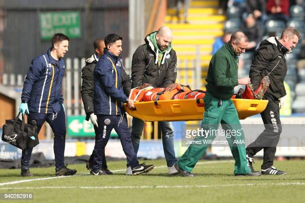 Aristote Nsiala of Shrewsbury Town goes off injured during the Sky Bet League One match between Rochdale and Shrewsbury Town at Spotland Stadium on...