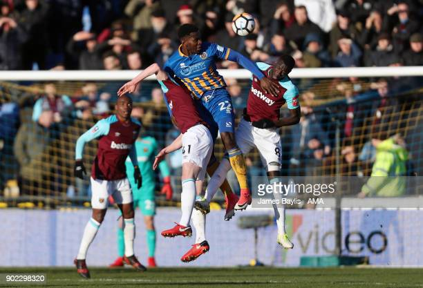 Aristote Nsiala of Shrewsbury Town is challenged by Cheikhou Kouyate and Declan Rice of West Ham United during The Emirates FA Cup Third Round...