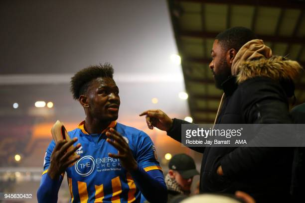 Aristote Nsiala of Shrewsbury Town talks to a fan at full time during the Sky Bet League One match between Bradford City and Shrewsbury Town at Coral...