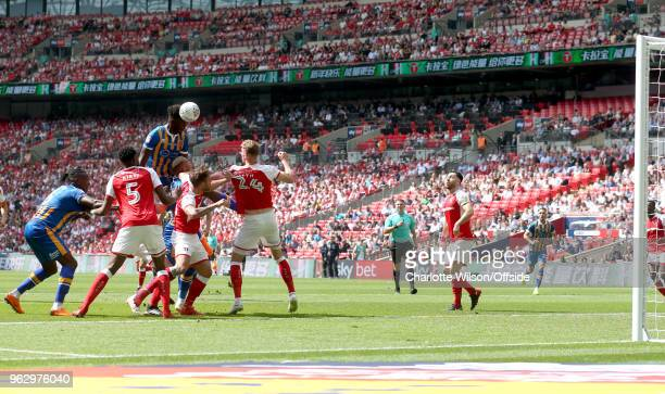 Aristote Nsiala of Shrewsbury wins a header but sends it wide during the Sky Bet League One Play Off Semi FinalSecond Leg between Rotherham United...