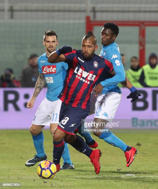 Aristoteles of Crotone competes for the ball with Amadou Diawara of Napoli during the serie A match between FC Crotone and SSC Napoli at Stadio...