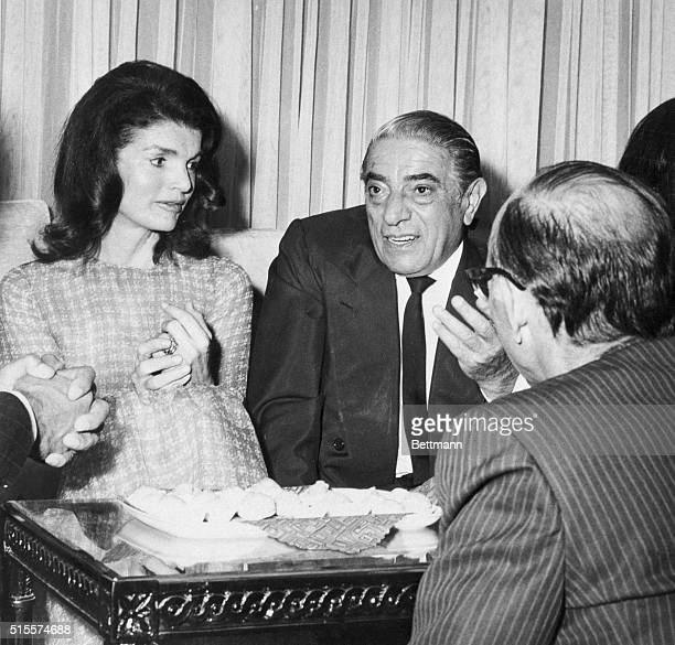 Aristotle and Jacqueline Onassis chat with guests at a party hosted by Dr. Reza Fallah. Tehran... May, 1972
