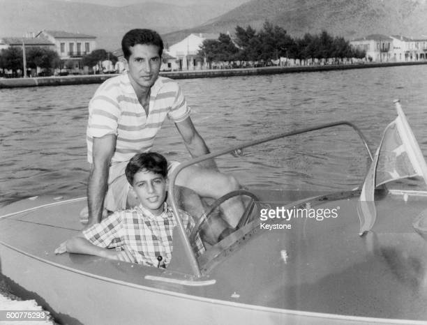 Aristotle Onassis and his son relaxing in their boat in Itea Greece circa 1930