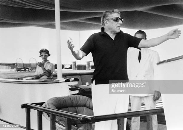 Aristotle Onassis shoos reporters away from his yacht ChristinaOnassis was also denying rumors that he was involved romantically with singer Maria...