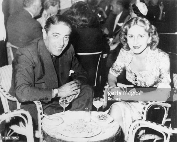 Aristotle Onassis sits with his first wife Athina at an Athens cafe