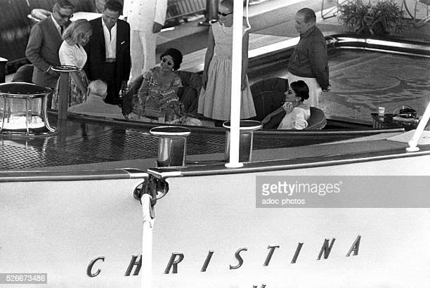 "Aristotle Onassis, Winston Churchill , Maria Callas and her husband Giovanni Battista Meneghini aboard ""Christina O"", yacht of the Greek shipping..."