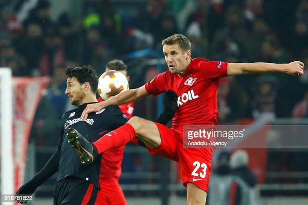 Aritz Aduriz of Athletic Bilbao and Dmitri Kombarov of Spartak Moscow vie for the ball during the UEFA Europa League round of 32 first leg soccer...