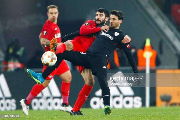 Aritz Aduriz of Athletic Bilbao and Serdar Tasci of Spartak Moscow vie for the ball during the UEFA Europa League round of 32 first leg soccer match...