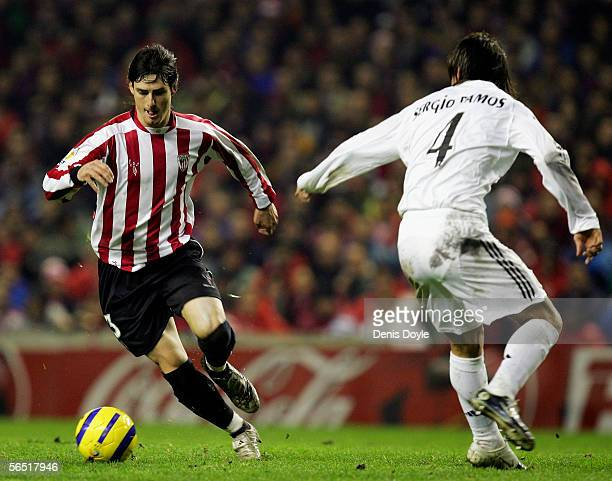 Aritz Aduriz of Athletic Bilbao dribbles the ball past Sergio Ramos of Real Madrid during the King's Cup 2nd round 1st leg match between Athletic...