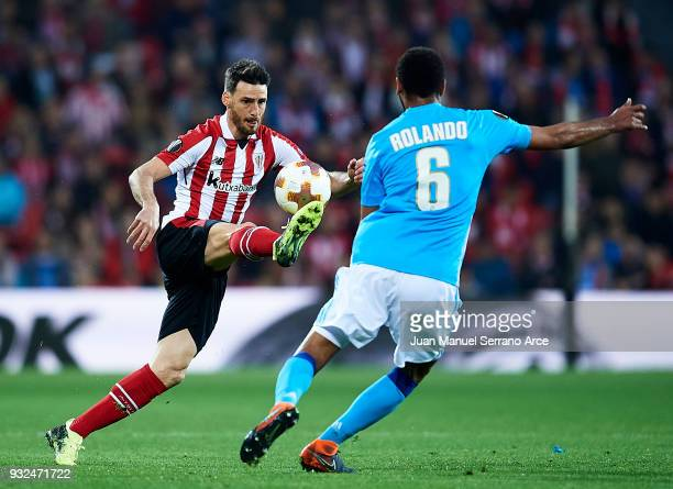 Aritz Aduriz of Athletic Bilbao duels for the ball with Rolando of Marseille during UEFA Europa League Round of 16 match between Athletic Club Bilbao...