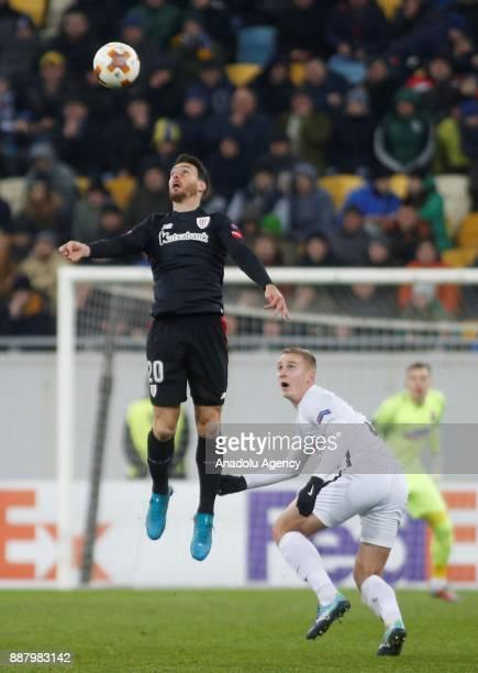 Aritz Aduriz of Athletic Bilbao in action against Oleksandr Svatok of Zorya Luhansk during the UEFA Europa League Group J soccer match between Zorya...