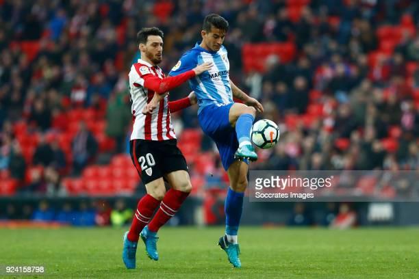 Aritz Aduriz of Athletic Bilbao Luis Hernandez of Malaga CF during the La Liga Santander match between Athletic de Bilbao v Malaga at the Estadio San...