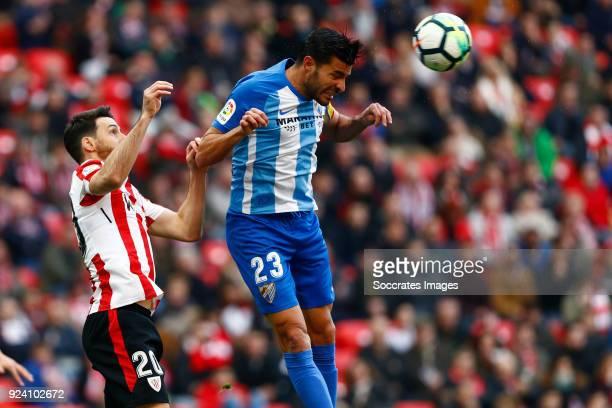 Aritz Aduriz of Athletic Bilbao Miguel Torres of Malaga CF during the La Liga Santander match between Athletic de Bilbao v Malaga at the Estadio San...