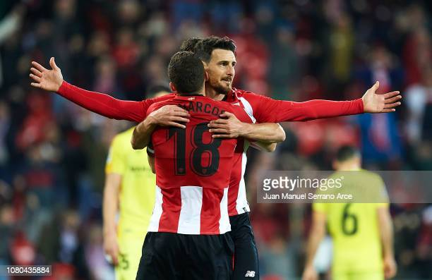 Aritz Aduriz of Athletic Club celebrates with his teammate Oscar De Marcos of Athletic Club after scoring the opening goal during the La Liga match...