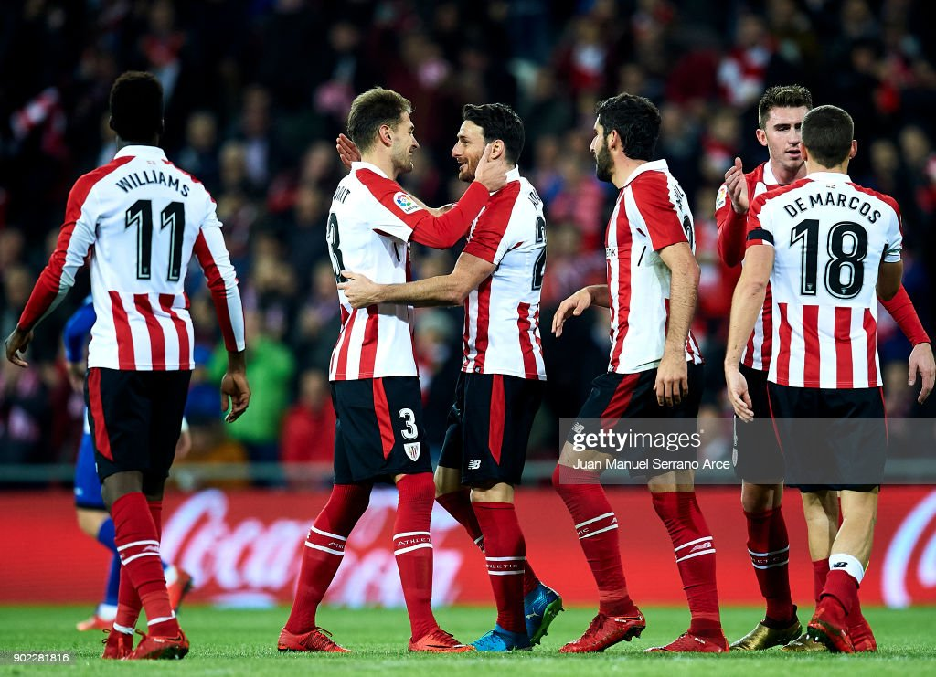 Aritz Aduriz of Athletic Club celebrates with his teammates Enric Saborit of Athletic Club after scoring his team's second goal during the La Liga match between Athletic Club Bilbao and Deportivo Alaves at San Mames Stadium on January 7, 2018 in Bilbao, Spain.