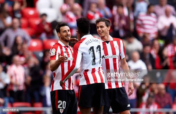 Aritz Aduriz of Athletic Club celebrates with his teammates Inaki Williams and Mikel San Jose of Athletic Club after scoring his team's second goal...