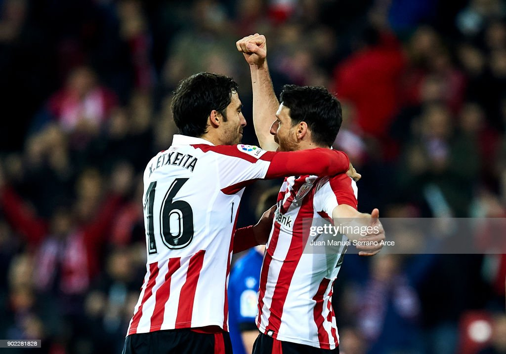 Aritz Aduriz of Athletic Club celebrates with his teammates Xabier Etxeita of Athletic Club after scoring his team's second goal during the La Liga match between Athletic Club Bilbao and Deportivo Alaves at San Mames Stadium on January 7, 2018 in Bilbao, Spain.