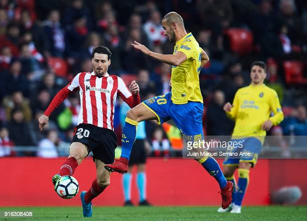 Aritz Aduriz of Athletic Club competes for the ball with Alejandro Galvez of Union Deportiva Las Palmas during the La Liga match between Athletic...