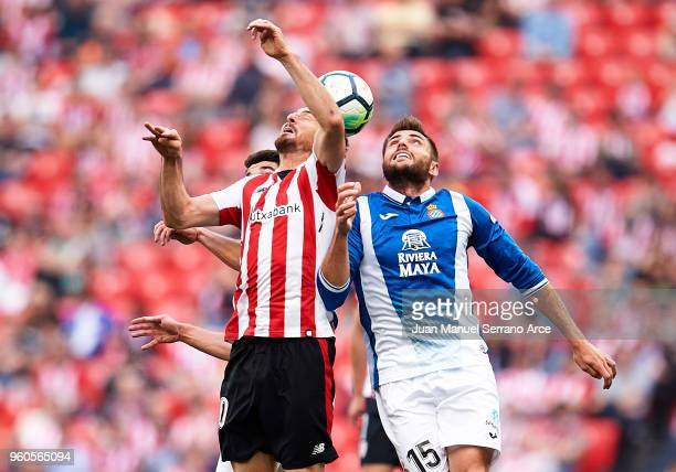 Aritz Aduriz of Athletic Club competes for the ball with David Lopez of RCD Espanyol during the La Liga match between Athletic Club and RCD Espanyol...