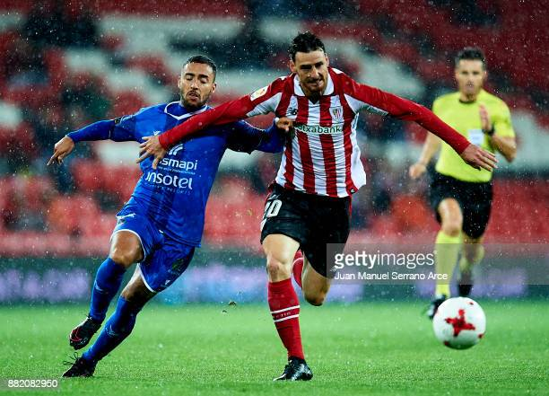Aritz Aduriz of Athletic Club duels for the ball with Agustin Armando Ojeda of SD Formentera during the Copa del Rey Round of 32 Second Leg match...