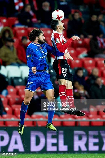 Aritz Aduriz of Athletic Club duels for the ball with Antonio Javier Rosa of SD Formentera during the Copa del Rey Round of 32 Second Leg match...