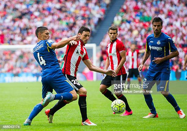 Aritz Aduriz of Athletic Club duels for the ball with Emiliano Velazquez of Getafe CF during the La Liga match between Athletic Club and Getafe CF at...