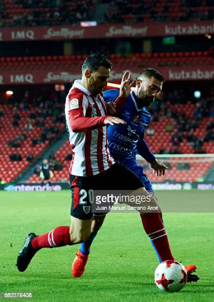 Aritz Aduriz of Athletic Club duels for the ball with Gabriel Gomez of SD Formentera during the Copa del Rey Round of 32 Second Leg match between...