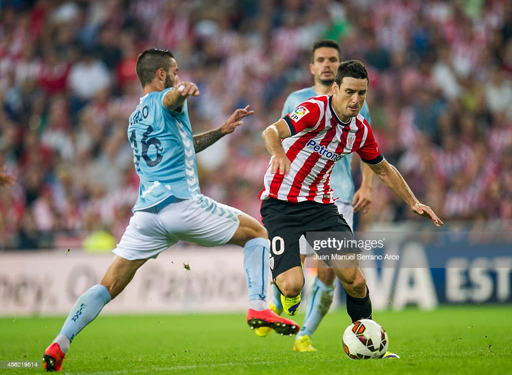 Aritz Aduriz of Athletic Club duels for the ball with Manuel Castellano ÔLillo' of SD Eibar during the La Liga match between Athletic Club and SD Eibar at San Mames Stadium on September 27, 2014 in Bilbao, Spain.
