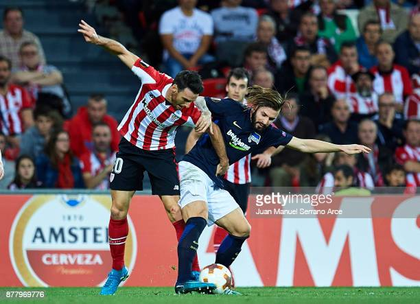 Aritz Aduriz of Athletic Club duels for the ball with Marvin Plattenhardt of Hertha BSC during the UEFA Europa League group J match between Athletic...