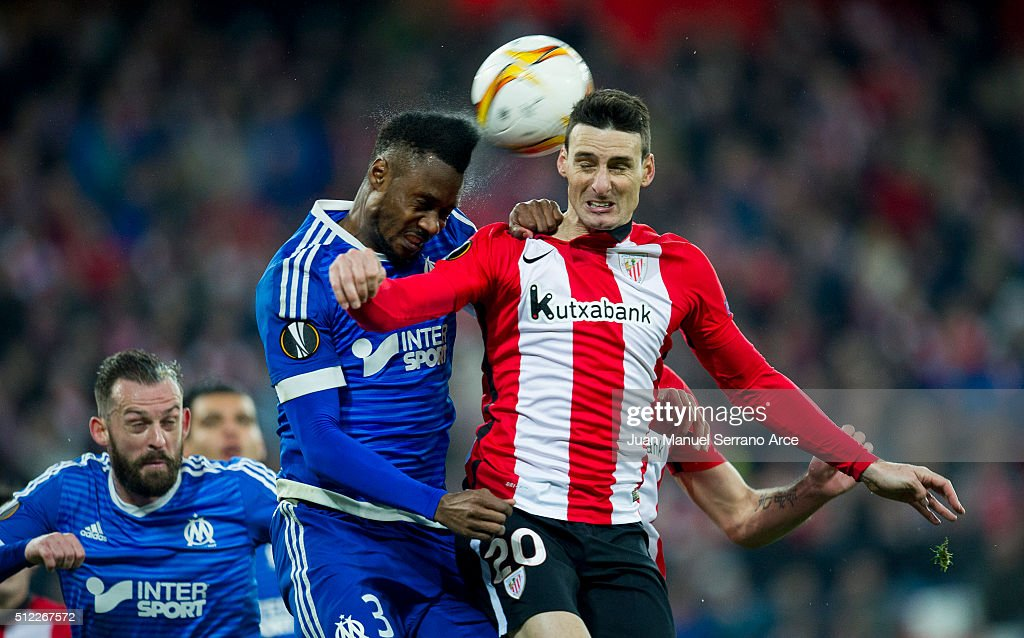 Aritz Aduriz of Athletic Club duels for the ball with Nicolas Nkoulou of Marseille during the UEFA Europa League Round of 32: Second Leg match between Athletic Club and Marseille at San Mames Stadium on February 25, 2016 in Bilbao, Spain.