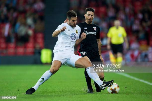 BILBAO SPAIN NOVEMBER 02 Aritz Aduriz of Athletic Club duels for the ball with Sotirios Papagiannopoulos of Ostersunds FK during the UEFA Europa...