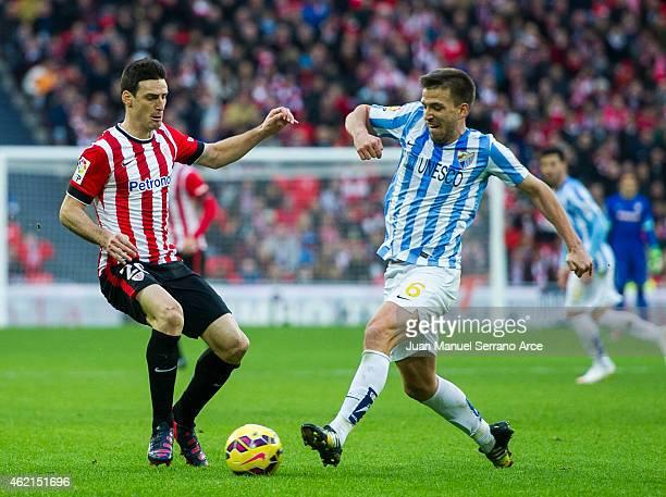 Aritz Aduriz of Athletic Club duels for the ball withÊIgnacio Camacho of Malaga CF during the La Liga match between Athletic Club and Malaga CF at...