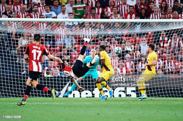 Aritz Aduriz of Athletic Club shoots for score the first goal of Athletic Club during the Liga match between Athletic Club and FC Barcelona at San...