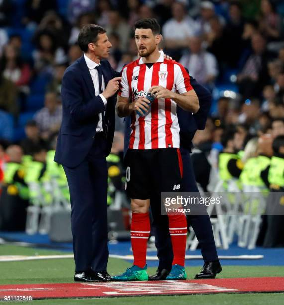 Aritz Aduriz of Athletic Club speaks with Cuco Ziganda of Athletic Club during the La Liga match between Real Madrid and Athletic Club at Estadio...