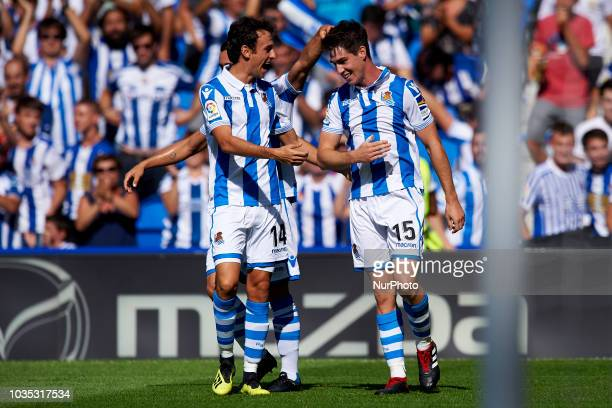 Aritz Elustondo celebrates after scoring his sides first goal whit Ruben Pardo during the match between Real Sociedad against FC Barcelona at Anoeta...
