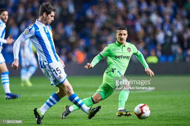 Aritz Elustondo of Real Sociedad being followed by Enis Bardhi of Levante UD during the La Liga match between Real Sociedad and Levante UD at Estadio...