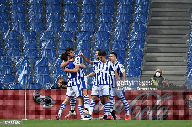 Aritz Elustondo of Real Sociedad celebrates with team mates after scoring his team's first goal during the La Liga Santander match between Real...