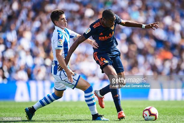Aritz Elustondo of Real Sociedad competes for the ball with Geoffrey Kondogbia of Valencia CF during the La Liga match between Real Sociedad and...