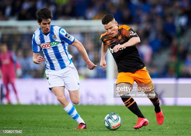 Aritz Elustondo of Real Sociedad duels for the ball with Kevin Gameiro of Valencia CF during the Liga match between Real Sociedad and Valencia CF at...