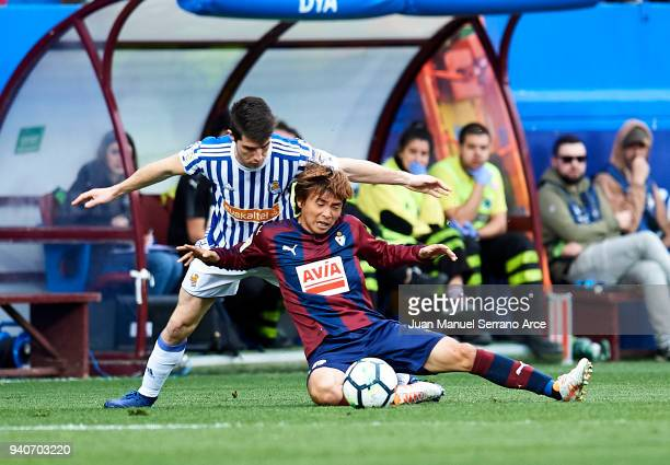 Aritz Elustondo of Real Sociedad duels for the ball with Takashi Inui of SD Eibar during the La Liga match between SD Eibar and Real Sociedad de...