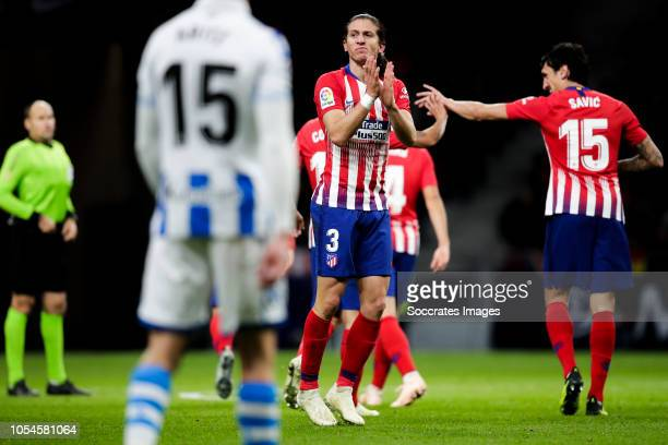 Aritz Elustondo of Real Sociedad Filipe Luis of Atletico Madrid Savic of Atletico Madrid during the La Liga Santander match between Atletico Madrid v...