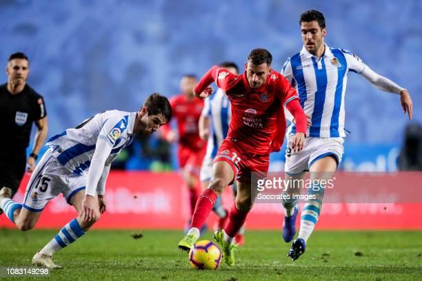 Aritz Elustondo of Real Sociedad Leo Baptistao of Espanyol Mikel Merino of Real Sociedad during the La Liga Santander match between Real Sociedad v...