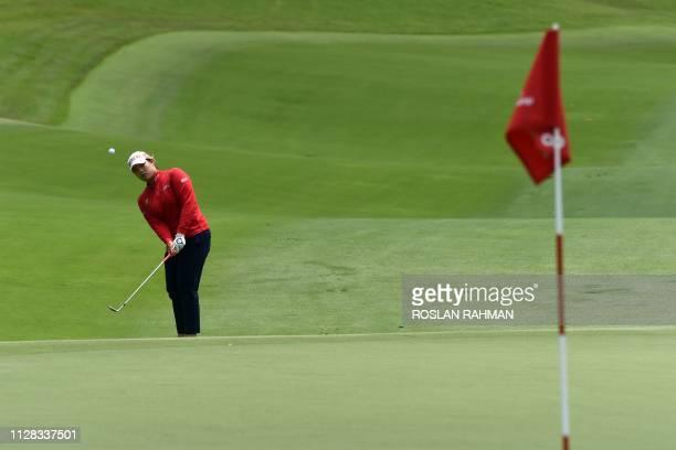 Ariya Jutanugam of Thailand hits a shot during the third round of the HSBC Women's World Championship at Sentosa Golf Club in Singapore on March 2...