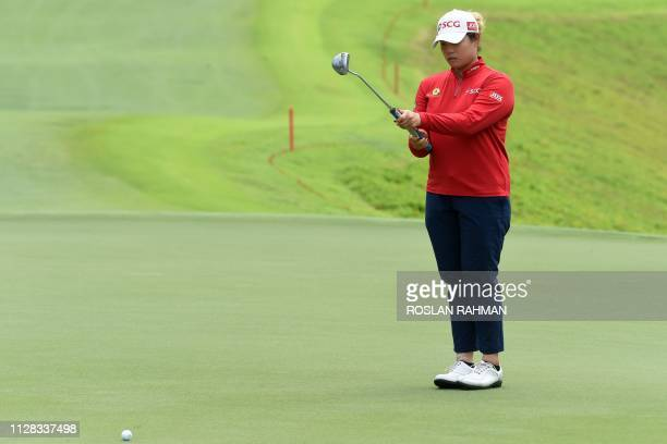 Ariya Jutanugam of Thailand lines up a putt during the third round of the HSBC Women's World Championship at Sentosa Golf Club in Singapore on March...
