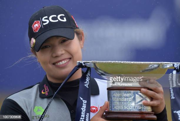 Ariya Jutanugarm of Thailand poses with the trophy as she wins the Ladies Scottish Open during the final day of the Aberdeen Ladies Scottish Open at...