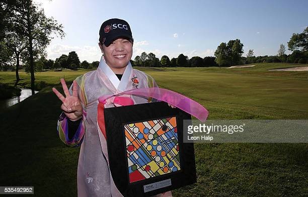Ariya Jutanugarn from Thailand poses in traditional Korean dress and poses with the championship trophy after winning the LPGA Volvik Championship on...