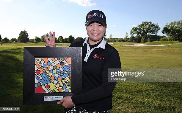 Ariya Jutanugarn from Thailand poses with the championship trophy after winning the LPGA Volvik Championship on May 29 2016 at Travis Pointe Country...