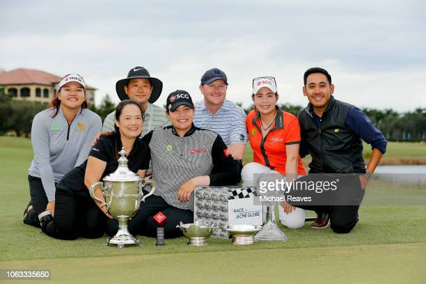 Ariya Jutanugarn of Thailand and her family pose for a photo with the Rolex Player of the Year trophy Leaders Top 10 Competition Trophy Vare trophy...