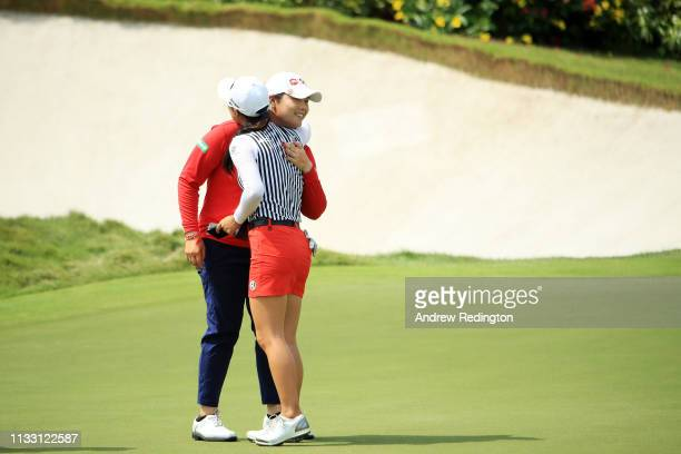 Ariya Jutanugarn of Thailand and Minjee Lee of Australia hug after finishing on the 18th green during the third round of the HSBC Women's World...